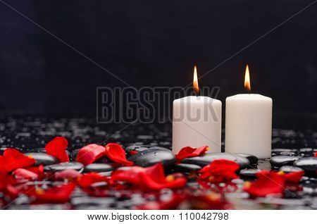 Beautiful rose ,petals with white candle and therapy stones