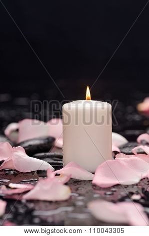 Set of rose petals with candle and therapy stones