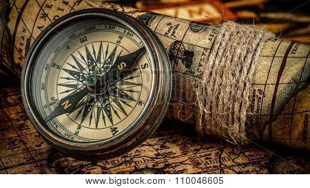 Travel geography navigation concept background - panorama of  old vintage retro compass on ancient world map