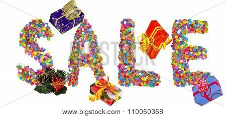 Word Sale Formed Of Colorful Confetti With Christmas Decorations And Gift Boxes.