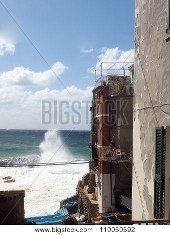Riomaggiore Cinque Terre Italy Waves Breaking Against Historic Homes Rough Sea