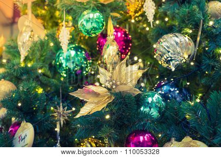Closeup of Christmas tree decorations background ( Filtered image processed vintage effect. )