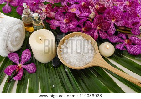 Spa set with orchid ,spa oil ,towel, salt in bowl ,candle on palm leaf