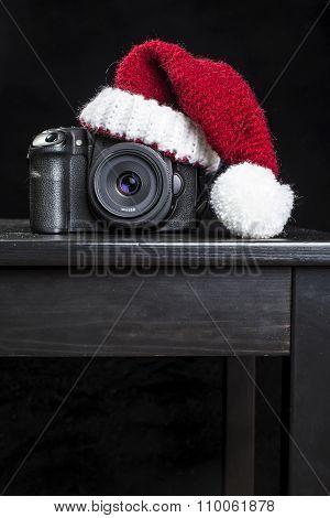 Dslr Camera In A Red Christmas Hat Of Santa Claus