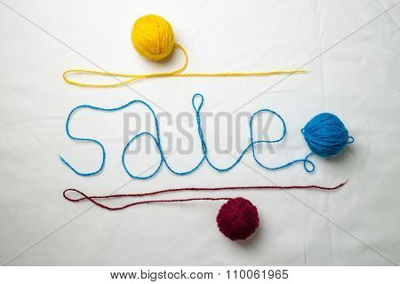 Word Sale Written Multicolored Yarn Threads Coiled Into Balls