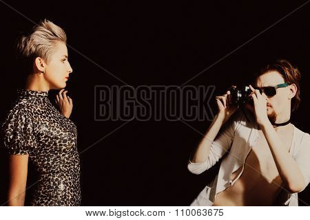 Man Photographing A Young Women