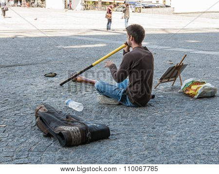 Young Man Plays Didgeridoo Outside Centre Pompidou, Paris, France