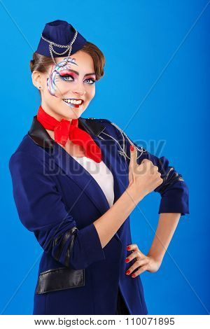 Stewardess With Face Art Shows Thumb Up.