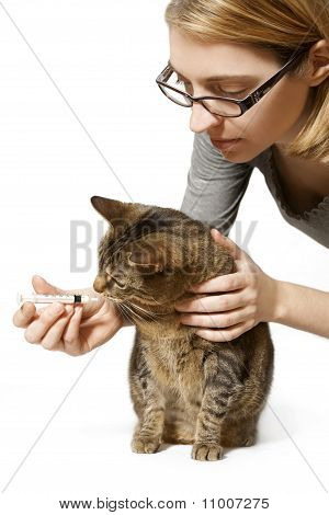 Woman Giving Cat Medication