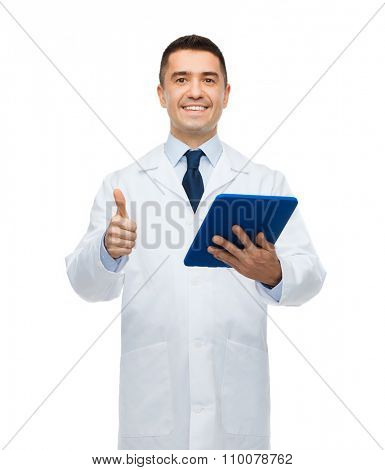 healthcare, profession, people and medicine concept - smiling male doctor in white coat with tablet pc showing thumbs up gesture