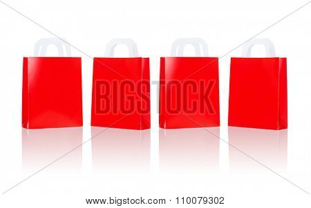 sale, consumerism, advertisement and retail concept - many blank red shopping bags