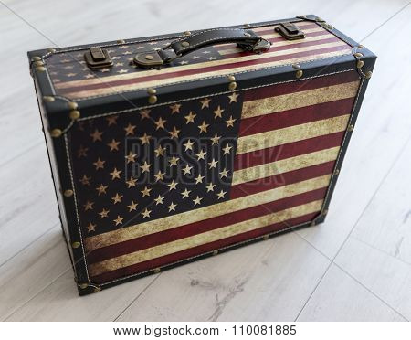 Old style voyage suitcase with travel stickers and flags