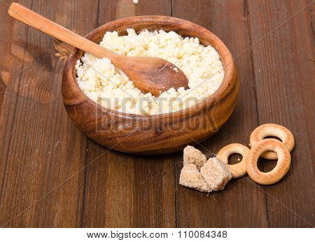 Rural Meal From Millet Cereal In A Wooden Bowl, Steering-wheels And Lumpy Sugar