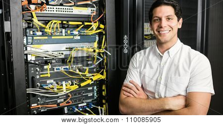 Confident technician smiling at camera at the data centre