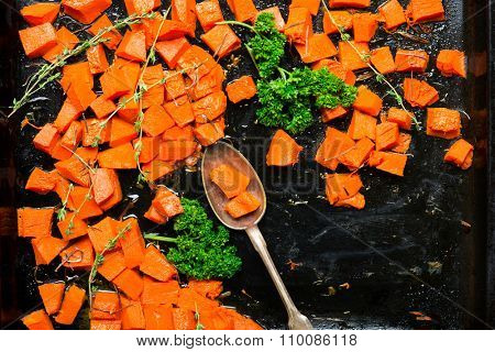 Baked pumpkin with herbs. Vegetarian garnish, close-up