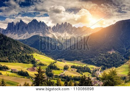 Countryside view of the valley St. Magdalena or Santa Maddalena in the National park Puez Odle or Geisler. Dolomites, South Tyrol. Location Bolzano, Italy, Europe. Dramatic unusual scene. Beauty world
