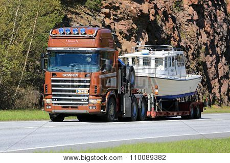 Scania 144 Hauls A Recreational Boat Along Highway