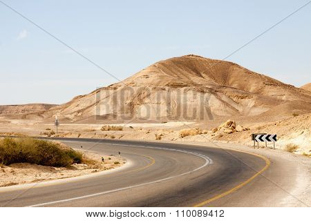 Empty Road With Left Turn In A Mountains