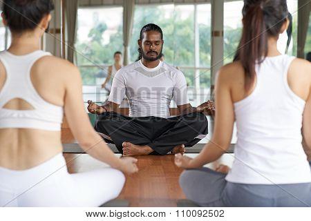 Conducting yoga class
