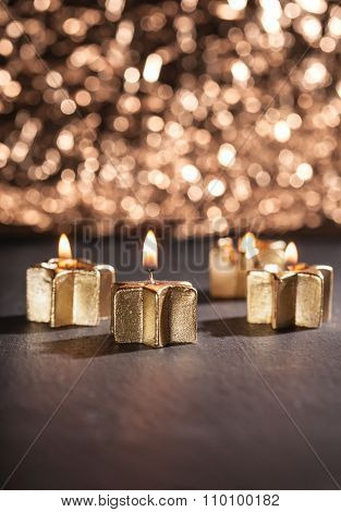 Four Golden Advent Candles Lit With Bokeh Background