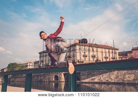 Handsome Asian Model Jumping In The City Streets