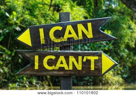 I Can - I Can't signpost with forest background