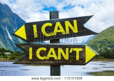 I Can - I Can't signpost with mountains background