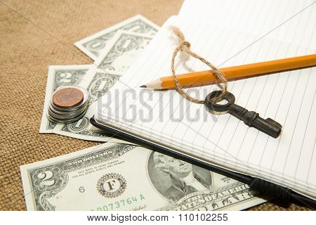 Opened Notebook, Pencil And Money On The Old Tissue