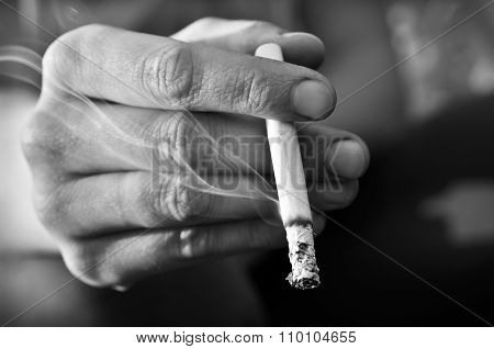 Hand Smoker Holding A Lighted, Smoking A Cigarette