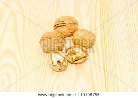 Several Walnuts On A Wooden Surface