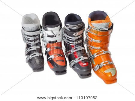 Several Alpine Ski Boots On A Light Background