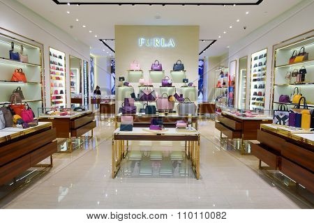 SINGAPORE - NOVEMBER 08, 2015: interior of Furla store in The Shoppes at Marina Bay Sands. Furla features Italian-designed products that range from handbags and shoes to accessories