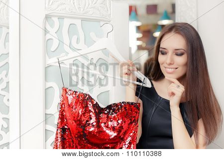 Happy Girl Trying on Red Party Dress in Dressing Room