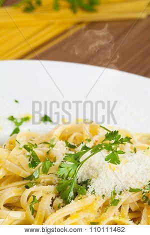 Close up view of Spaghetti Aglio e Olio, an Italian recipe of pasta.