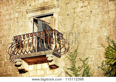 Abandoned House With Rusty Wrought Iron Balcony