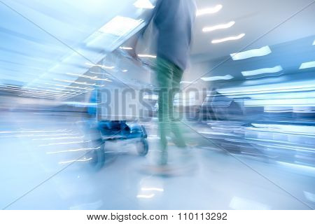 Traveling Woman In Airport Terminal. Abstract Motion Blur