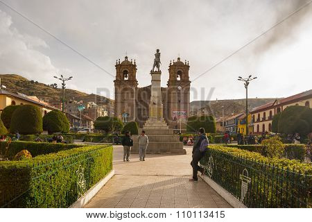People On Main Square And Cathedral Of Puno, Peru