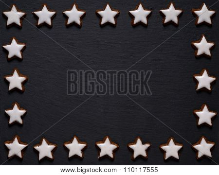 black slate board with star-shaped cookie frame