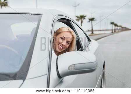 Smiling Woman Looking Out From The Car Window