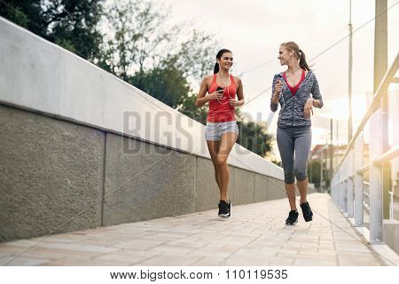 Beautiful Women Jogging In Sunset