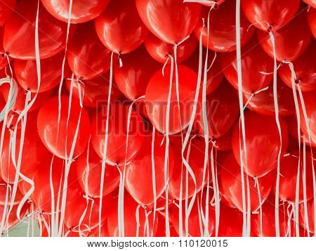 Red Balloons Hanging Under A Ceiling