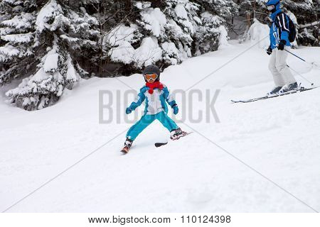 Adorable Little Boy With Blue Jacket And A Helmet, Skiing In Winter
