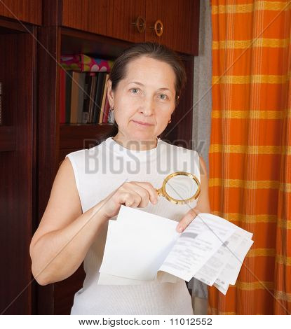 Woman Looking At Utility Bills