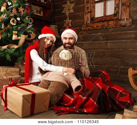 Christmas Couple In A Rural Wooden House Played A Plush Toy