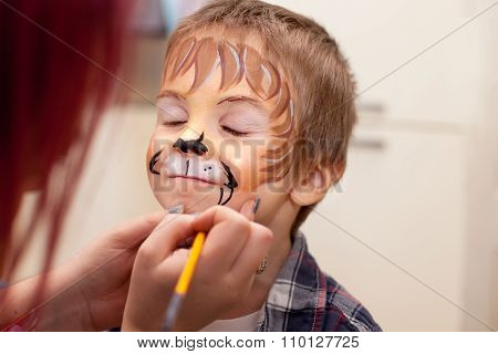Little Boy With Painted Face As A Lion