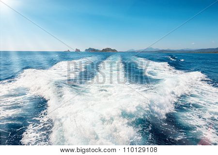 Waves On Blue Sea Behind The Boat