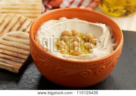 Hummus topped with whole chickpeas, and olive oil