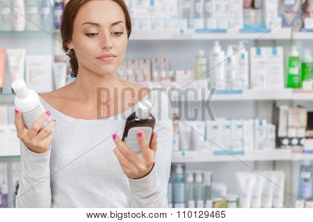 Girl can't decide what to buy in drugstore