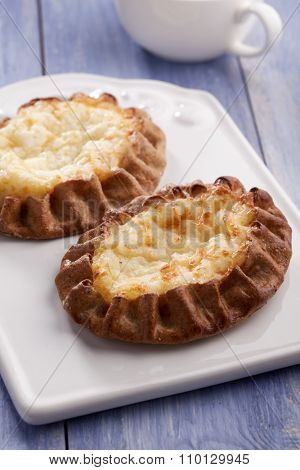 Karelian pasty with rice on a rustic table