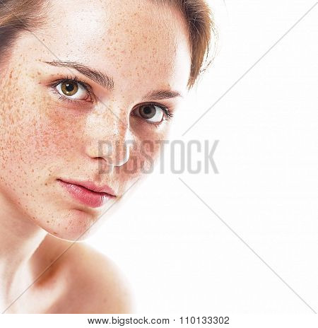 Studio Beauty. Portrait Of Smiling Young And Happy Woman With Freckles. Isolated On White.